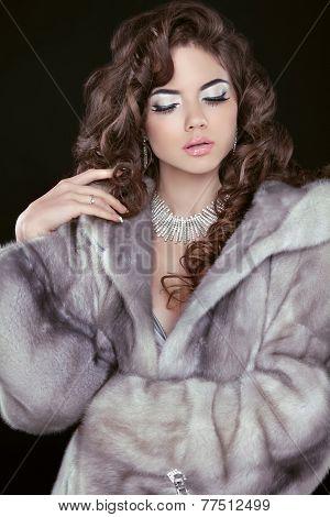 Beauty Fashion Model Girl In Blue Mink Fur Coat. Beautiful Luxury Winter Woman Isolated On Black Bac