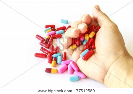 Various Pills In Hand