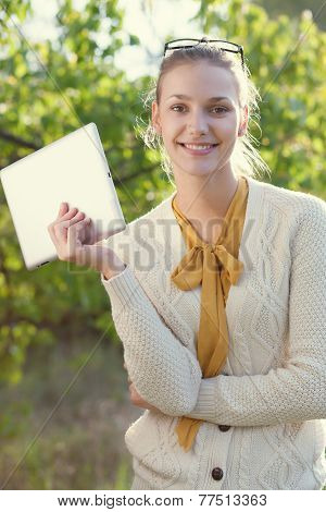 Happy Young Woman Holding An Ipad Outdoors