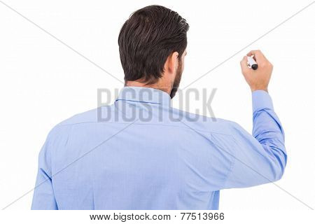 Businessman in suit writing with marker on white background