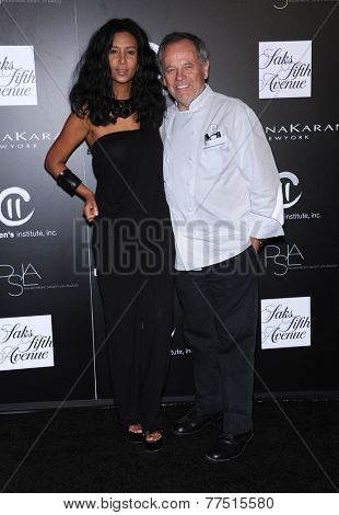 LOS ANGELES - OCT 08:  Wolfgang Puck & Gelila Assefa arrives to the 5th Annual PSLA Autumn Party  on October 8, 2014 in Culver City, CA