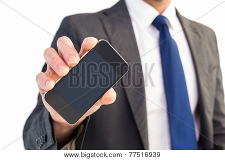 Businessman showing his smartphone screen on white background