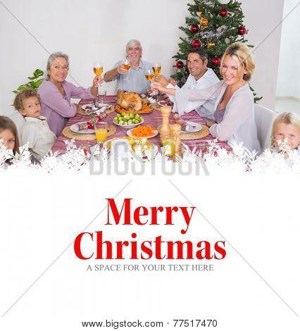 Family raising their glasses at christmas against merry christmas