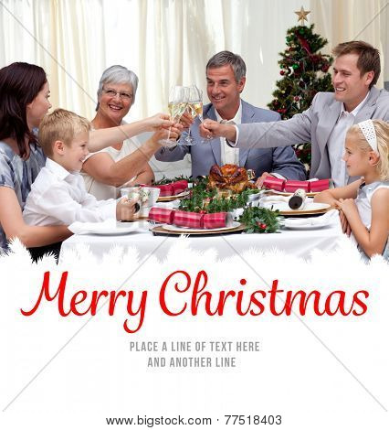 Family drinking a toast in a Christmas dinner against merry christmas