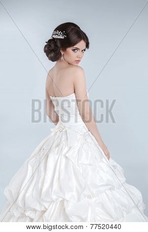 Beauty Fashion Young Bride Model Posing In Wedding Dress With Hairstyle, Studio Photo