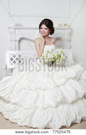 Beautiful Attractive Bride In Wedding Luxurious Dress Posing In Modern Interio