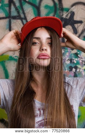 trendy beautiful long haired model posing on graffiti background