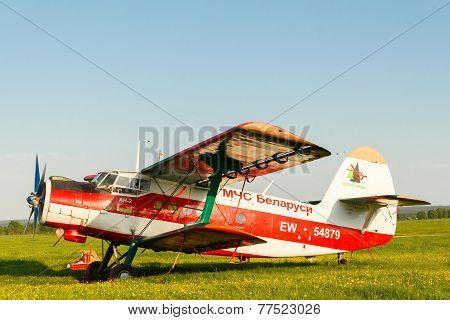 Light Aircraft On A Green Field.