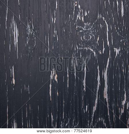 Background Consisting Of Wood With Black Peeling Paint