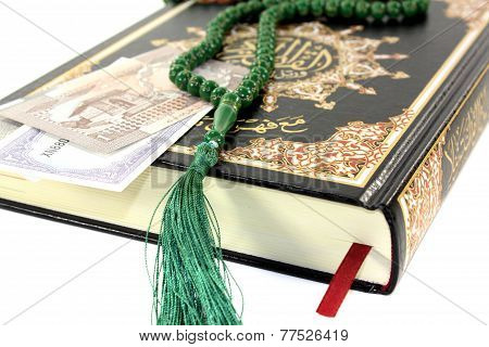 Slammed Quran With Pakistani Rupee