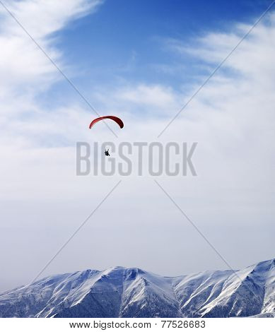 Paraglider Silhouette Of Mountains In Windy Sky At Sun Day