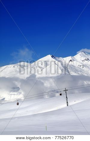 Winter Snowy Mountains And Cable Car At Nice Day