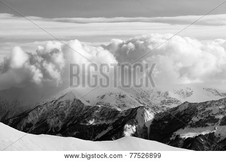 Black And White Snowy Mountains In Clouds And Off-piste Slope