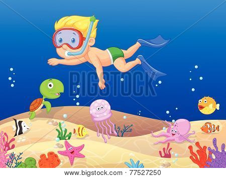 Little boy diving in the ocean