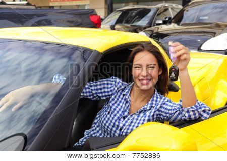 Woman Showing Keys Of Her New Sports Car