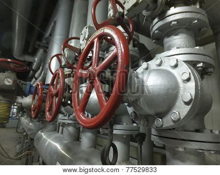 Pipes And Valves With Red Knobs