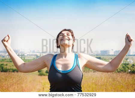 Happy Beautiful Successful Plus Size Woman Raising Arms To The Sky