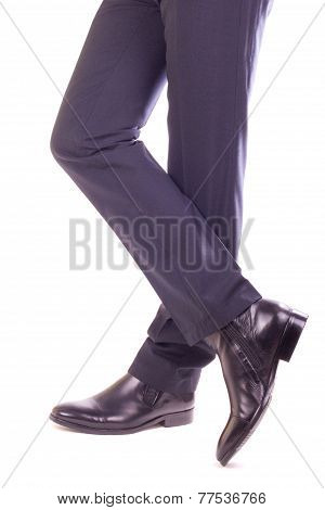 Businessman Standing With Crossed Legs
