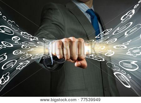 Close up of businessman grasping light in fist