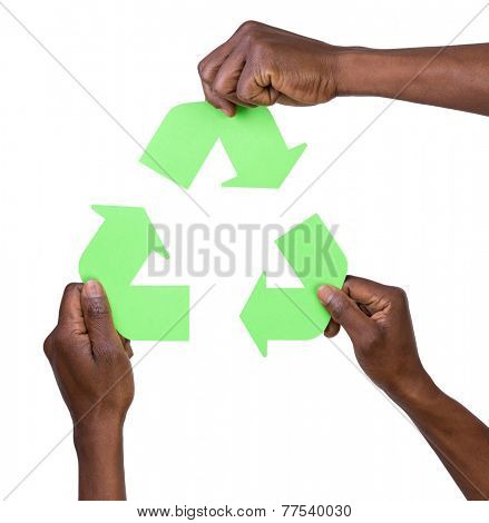 Hand holding green recycling arrows symbol. Ecology concept on white background