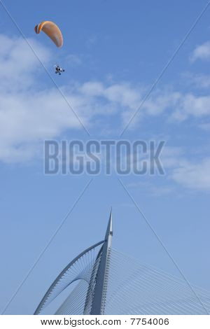 Paragliding Enthusiasts Flying In Blue Sky