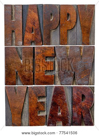 Happy New Year greetings or wishes - a word abstract in vintage letterpress wood type blocks with ink patina