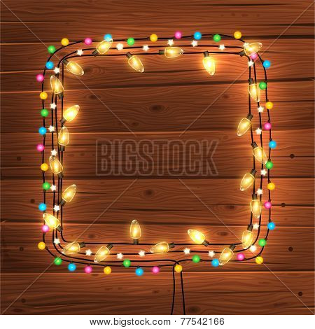 Glowing Christmas Lights Frame for Xmas Holiday Greeting Cards Design. Wooden Hand Drawn Background.
