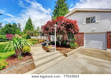House Exterior With Brick Wall Trim. Front Yard Landscape