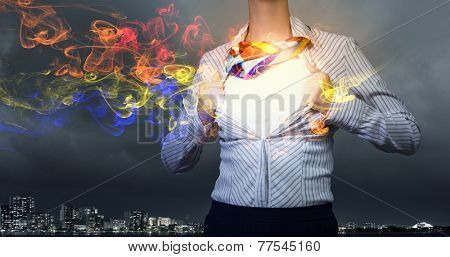 Young woman tearing shirt on chest. Creativity concept
