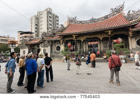 TAIPEI, TAIWAN - November 16th : Tourists and believers in the square of Longshan Temple, Taiwan on November 16th, 2014.