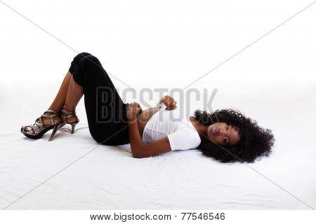Skinny Black Teen Girl Reclining On Back