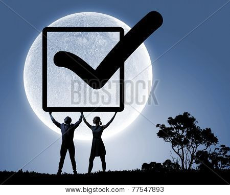 Silhouettes of young couple holding checkbox with tick