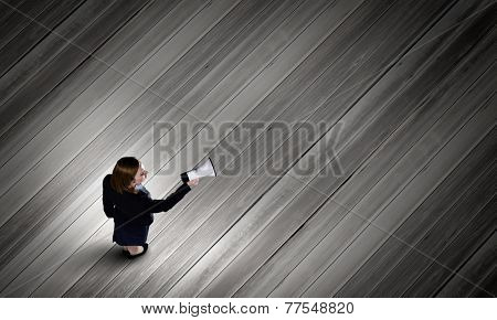 Top view of businesswoman with megaphone in hand