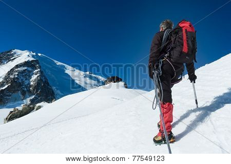 Mountaineer walking on the glacier during the climb of Mont Blanc. Chamonix, west Alps, France, Europe.