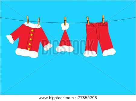 Santa claus clothes on the clothesline on a blue background.  EPS vector format.