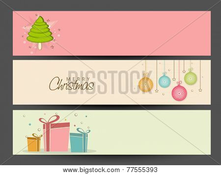 Merry Christmas celebration website header or banner set with X-mas Tree, gifts and hanging X-mas Balls.