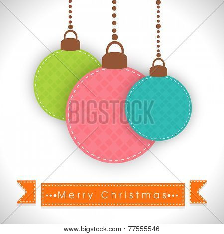 Colorful hanging X-mas balls with stylish text for Merry Christmas celebrations.