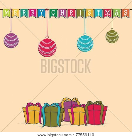 Beautiful decoration with colorful bunting, X-mas ball and gift boxes for Merry Christmas party celebrations.
