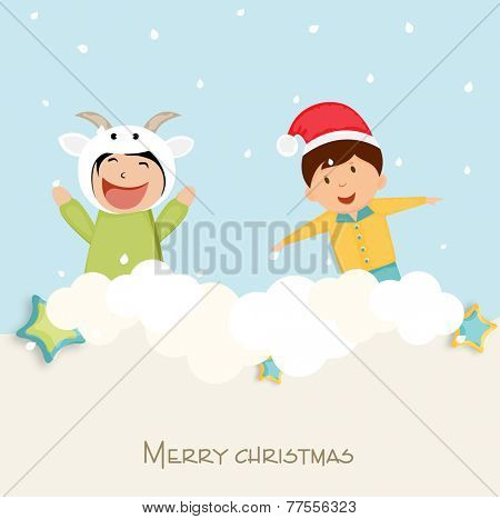 Cute little kids playing with snow for Merry Christmas celebration on winter background.
