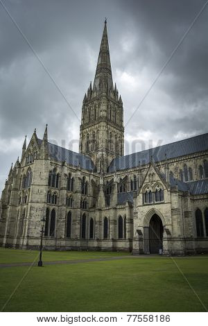 Salisbury cathedral under moody sky
