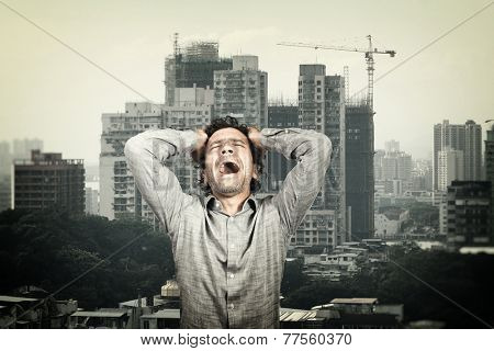stressed man and town background