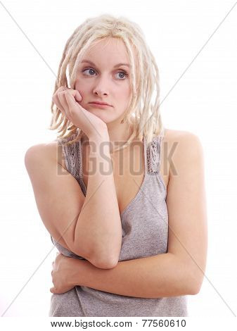sad woman with blonde dreadlocks