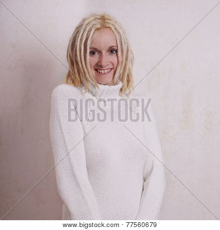 young woman with blonde dreadlocks