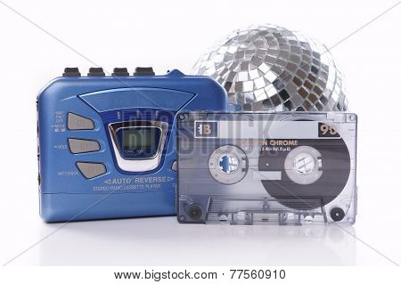music cassette walkman and disco ball