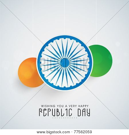 Beautiful hanging stickers in national flag color with Ashoka Wheel on shiny sky blue background for Indian Republic Day celebration.