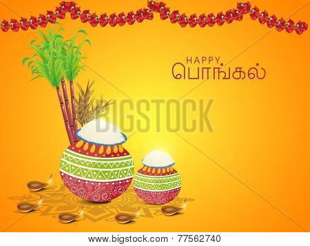 South Indian harvesting festival concept with wishes in Tamil text (Happy Pongal), Floral decorated traditional pots, sugarcane, wheat grain and illuminated oil lit lamps on yellow background.