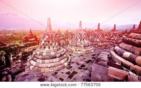 Beautiful ancient monument of Borobudur Buddhist temple in sunset,  Yogyakarta, Java Indonesia.