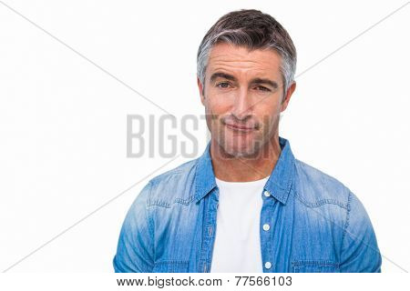 Portrait of a unsure man in casual clothes on white background