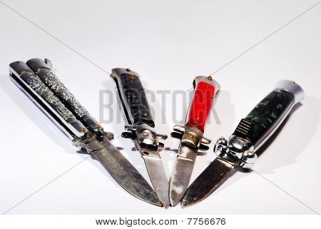 different switchblades and folding knives