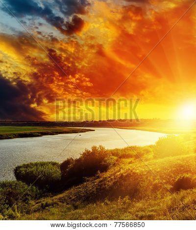 fantastic red sunset over river